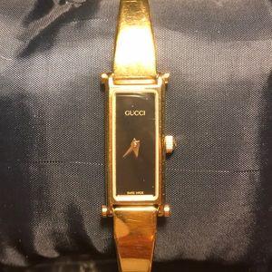Gucci vintage gold watch